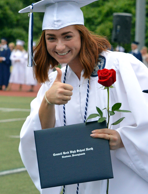 . Marissa Haynes gave thumbs up to graduation of Council Rock North Graduation 2018 on June 20, 2018. Debby High for Digital First Media