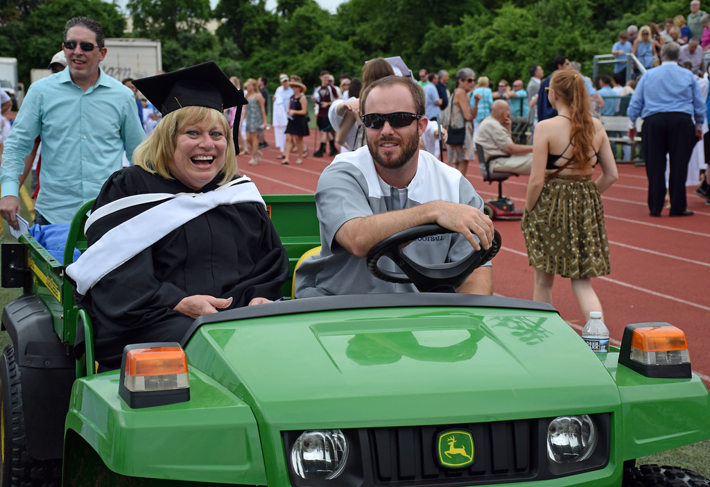 . Principal Susan McCarthy catches a ride following the ceremony. (photo by Debby High)