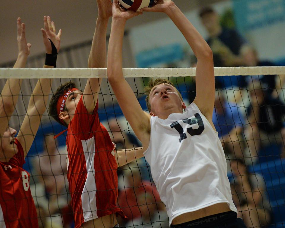 . Nick Baniewicz (19)  sets at the net. (photo by John Gleeson)