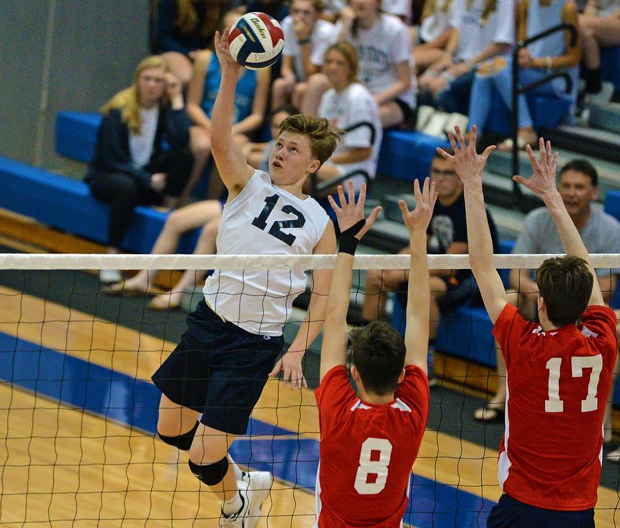 . Harry Wyatt (12) goes high over the net. (photo by John Gleeson)