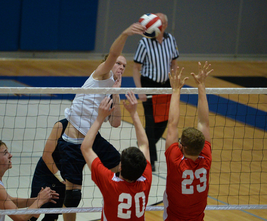 . Keven D\'Arcy (16) goes for a slam shot. (photo by John Gleeson)