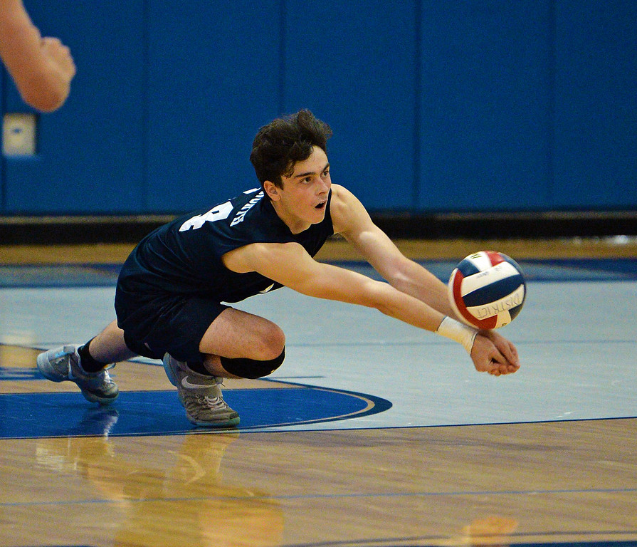 . Eddie Mancinelli (14) digs out low shot (photo by John Gleeson)