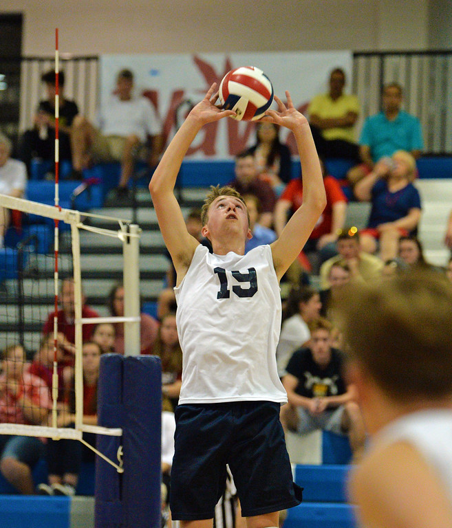 . Nick Baniewicz (19) sets ball for teammate. (photo by John Gleeson)