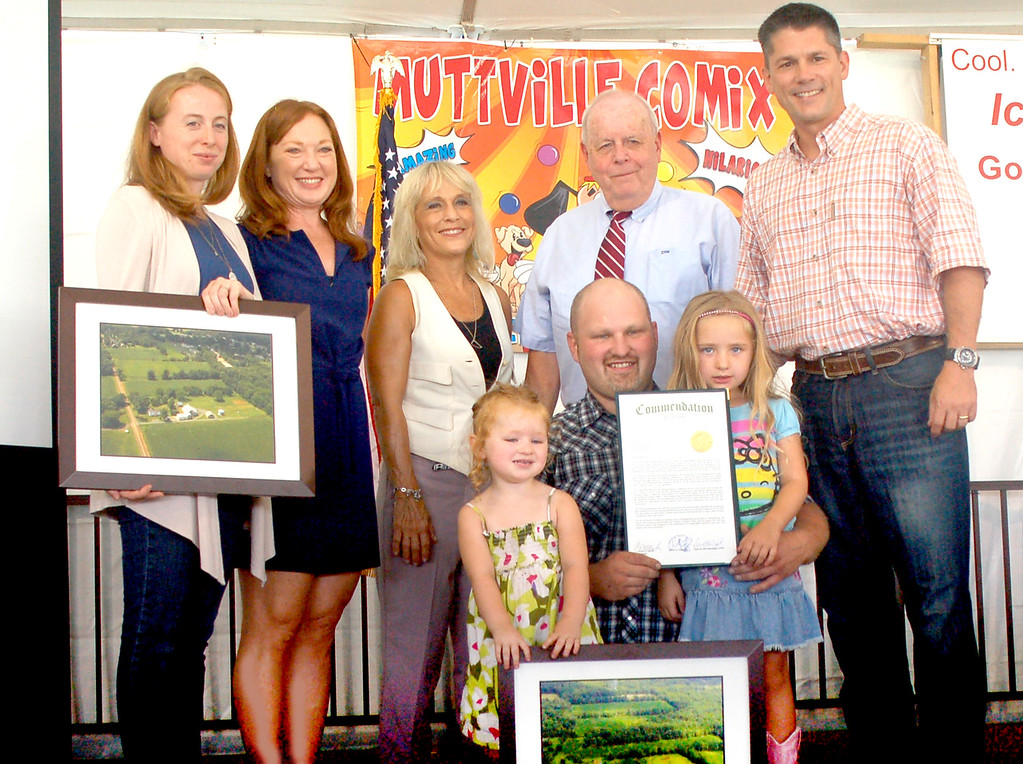 . Farmer of the Year Brian Bahnck, kneeling, in front, with his daughters Anna and Ella. In back are Gretchen Schatschneider, the district manager of the Bucks County Conservation District, the district�s agricultural conservation technician Rachel Onuska, and Bucks County Commissioners Diane Ellis-Marseglia, Chairman Charles Martin and Rob Loughery. Farmer of the Year Brian Bahnck, kneeling, in front, with his daughters Anna and Ella. In back are Gretchen Schatschneider, the district manager of the Bucks County Conservation District, the district�s agricultural conservation technician Rachel Onuska, and Bucks County Commissioners Diane Ellis-Marseglia, Chairman Charles Martin and Rob Loughery.