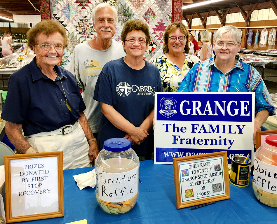 . Members of the Middletown Grange No. 684 promote the Grange Fair Experience at a booth inside one of the exhibition halls. From left are Ruth Wright, Bob and Marie Breeser, Diane Schonholtz and Sharon Kimmel (President). Grange is a grassroots, non-partisan, non-sectarian fraternal organization with its roots in agriculture. The local Grange is active in promoting programs for rural communities on the local, state and national level and prides itself on its community service activities.