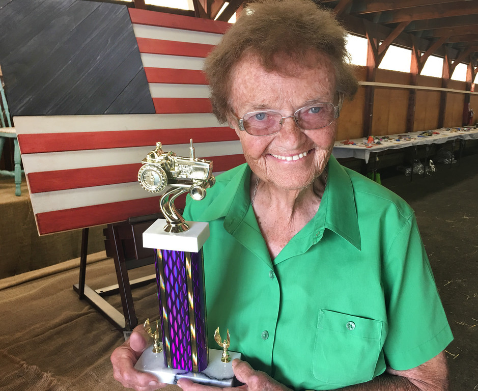 ". Ruth Wright of Lower Makefield with her first place trophy in the Slow Tractor Race. Twenty tractors, including Wright on her 1960 John Deere 1020, competed in the race, which covered just 15 feet and, in Ruth\'s words, progressed ""slower than a snail.\"""
