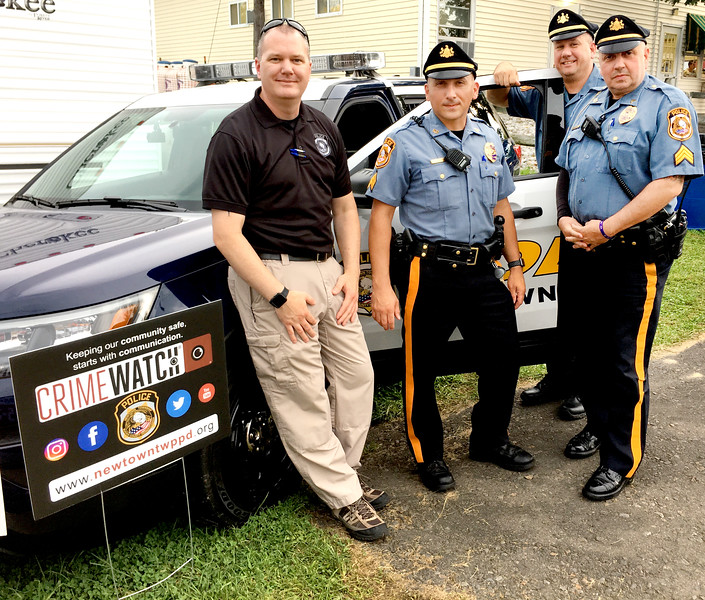 Handing out public safety information and helping to keep the Grange Fair safe are members of the Newtown Township Police Department: Det. Daniel Bartle, Sgt. Robert Lupinetti, Sgt. Daniel Bell and Cpl. Paul Deppi.