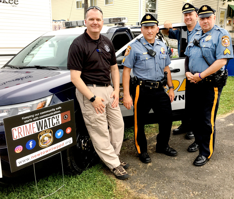 . Handing out public safety information and helping to keep the Grange Fair safe are members of the Newtown Township Police Department: Det. Daniel Bartle, Sgt. Robert Lupinetti, Sgt. Daniel Bell and Cpl. Paul Deppi.