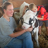 A Grange Fair visitor gives Carley, a three-month-old calf, a big hug. Carley was shown at the fair by Sandy Krone of Fountainville.