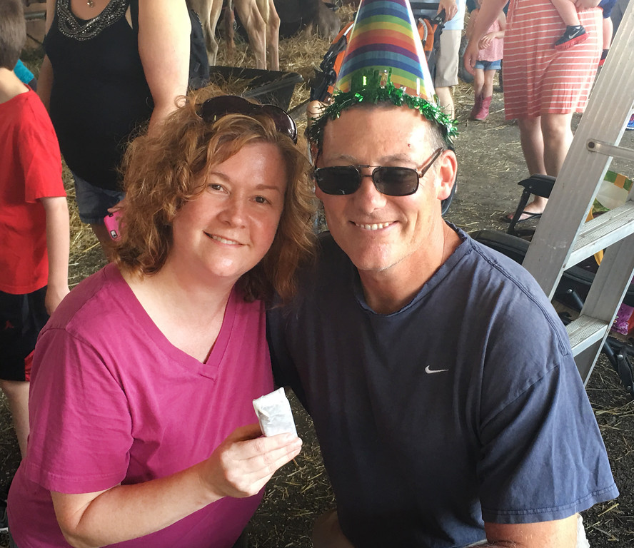 ". Abby O\'Keefe with her husband, Kevin, at the Grange Fair. Abby surprised her husband with an impromptu chorus of ""Happy Birthday\"" inside an animal barn at the fair before handing out free ice cream sandwiches to fairgoers. Kevin celebrated his 50th birthday on Friday."