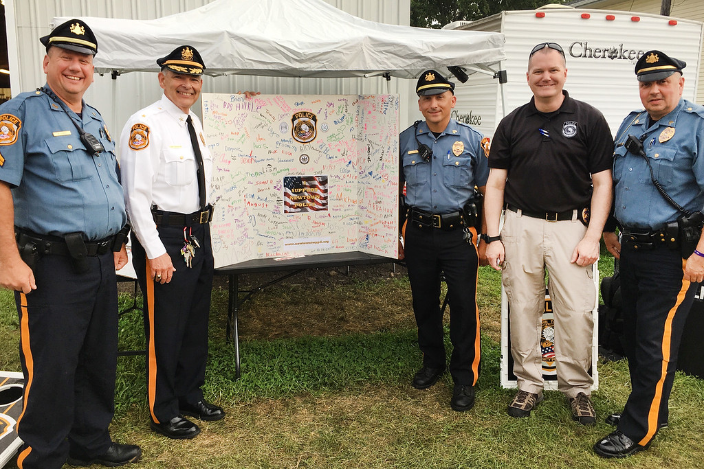 . Newtown Township Police Chief Rick Pasqualini and members of the department next to a poster filled with signatures and comments supporting local police. With the chief are Det. Daniel Bartle, Sgt. Robert Lupinetti, Sgt. Daniel Bell and Cpl. Paul Deppi.