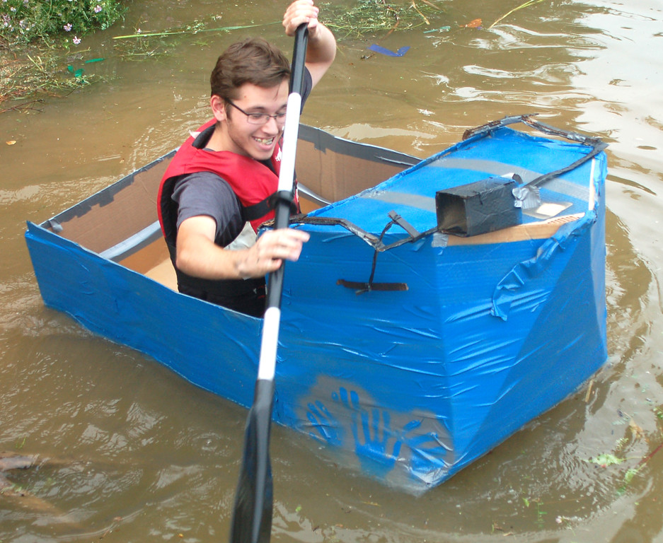 . Jason Frey\'s cardboard boat was the first to take on water and sink. He said next time he\'ll use more duct tape and provide a little more room for paddling.