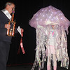 Mayor Charles Swartz presents the Mayor's Trophy to Macey Ludwig who dressed up as a jellyfish.
