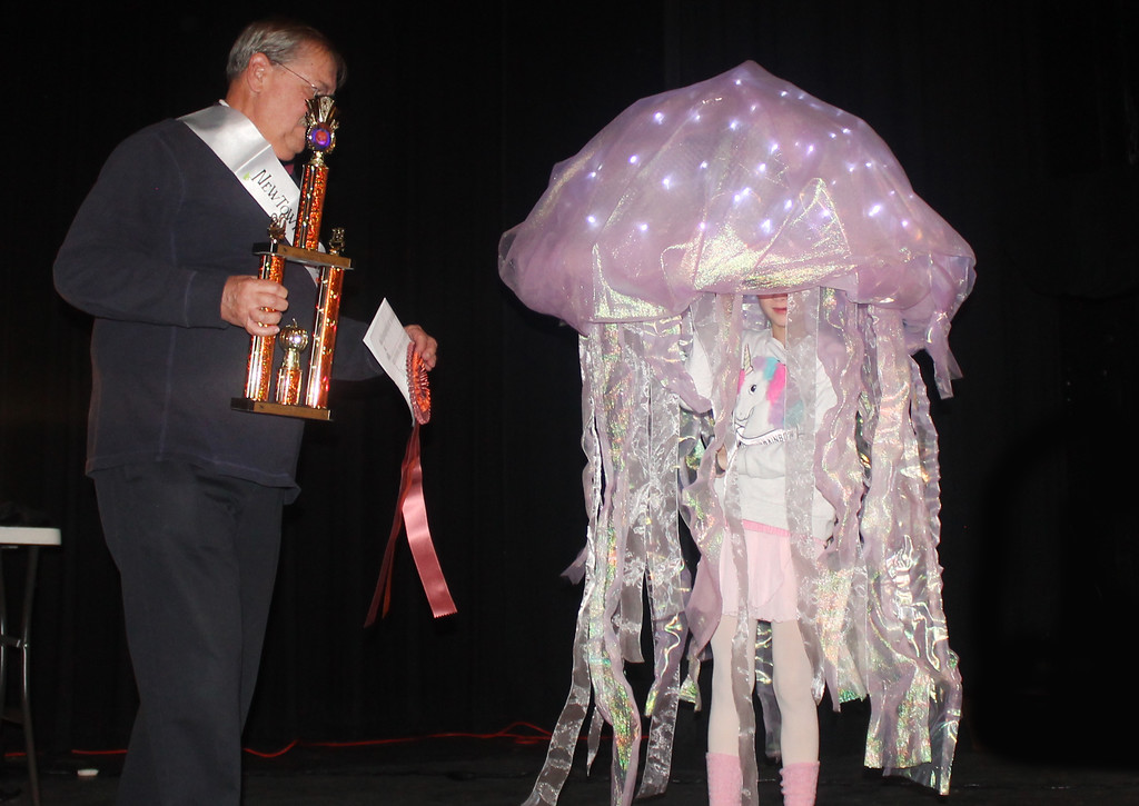 . Mayor Charles Swartz presents the Mayor\'s Trophy to Macey Ludwig who dressed up as a jellyfish.