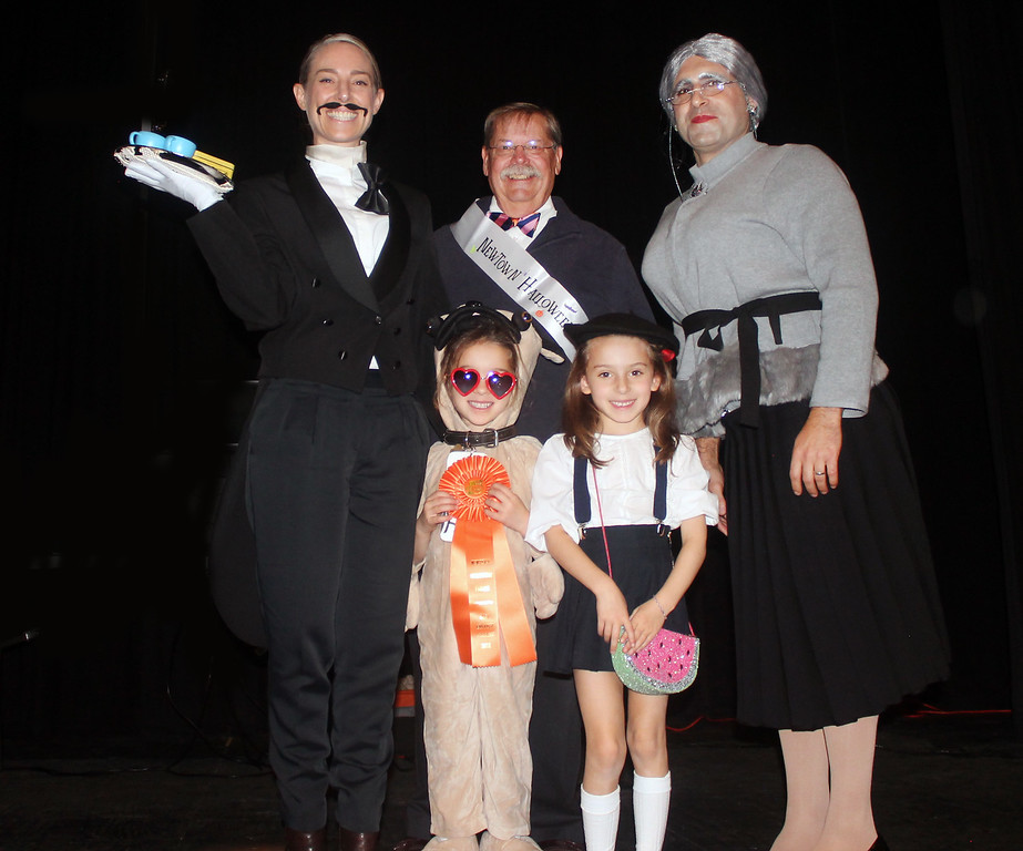 """. The Prousi Family - Anthony, Sommer, Delfine and Louisa - won the Boro Award for \""""Eloise.\"""" They are congratulated by Mayor Swartz, center, back."""