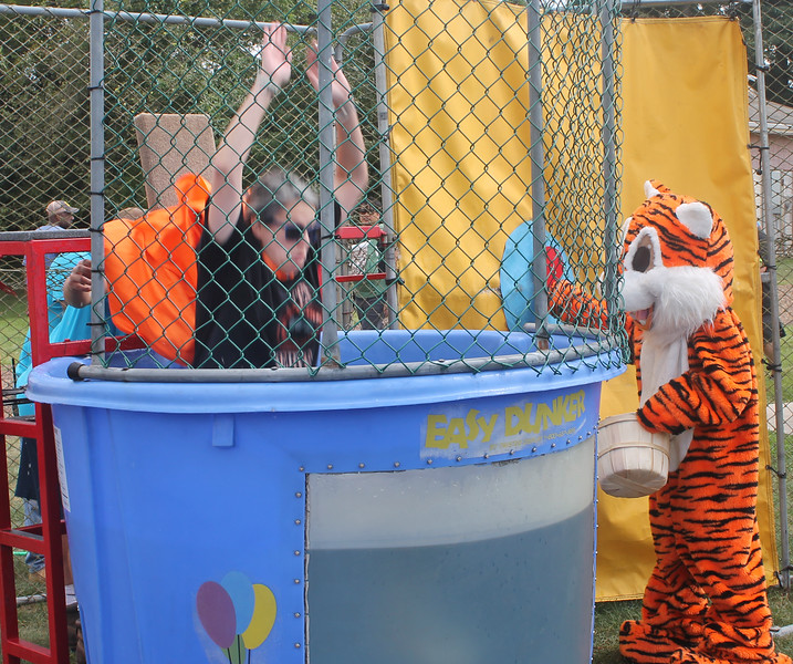 The Edgewood Tiger pulls a fast one, dunking the unexpecting principal.
