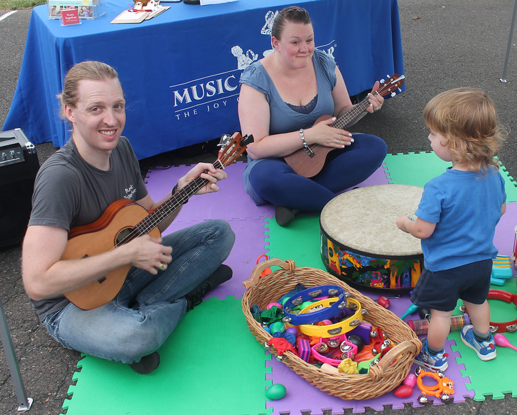"With an assortment of tambourines and drums, kids had a chance to make ""Music Together."""