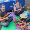 """With an assortment of tambourines and drums, kids had a chance to make """"Music Together."""""""