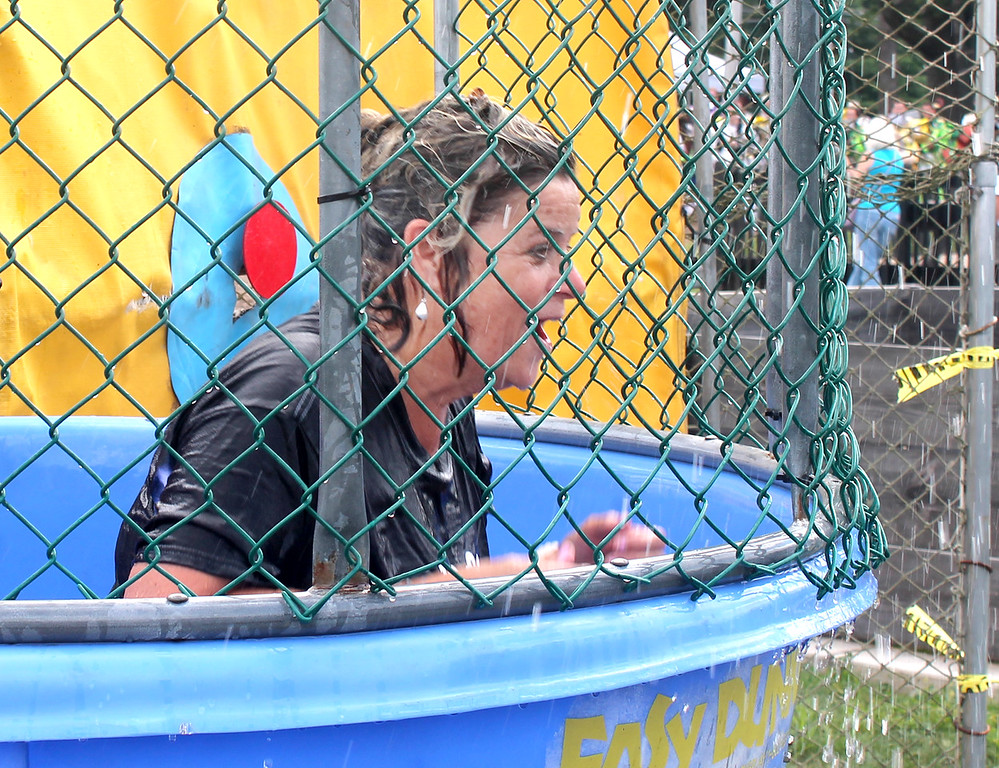 . Donna McCormick-Miller, principal of the Makefield Elementary School, emerges after being dunked at Community Pride Day. She donated proceeds from her time in the dunk tank to the Garden of Reflection.