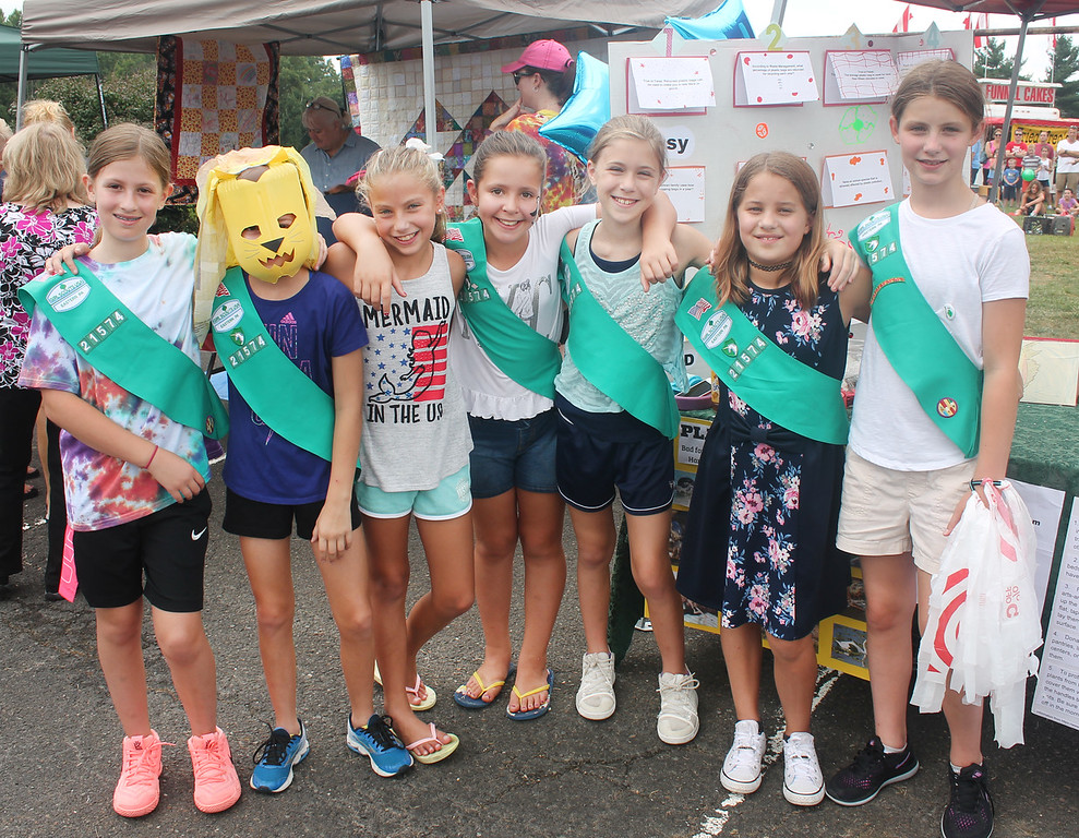 . Girls from Junior Girl Scout Troop 21574 raise plastic pollution awareness at their booth at Community Pride. Day.