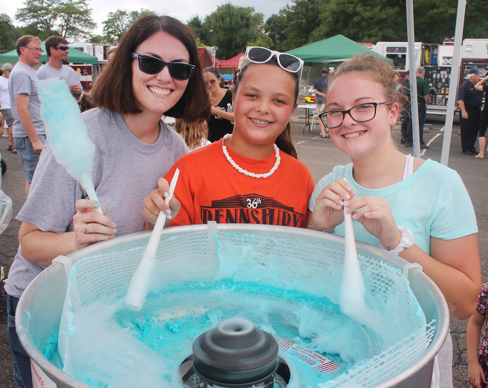 . On the cotton candy detail at the Cornerstone Church booth are Jennifer and Kayla Shaffer and Anna Evanchik.