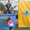 A student just misses the mark to dunk her principal, Edgewood's Stephanie Hultquist.