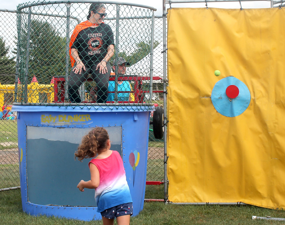 . A student just misses the mark to dunk her principal, Edgewood\'s Stephanie Hultquist.