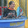 Edgewood Principal Stephanie Hultquist emerges from the dunk tank's cold waters.