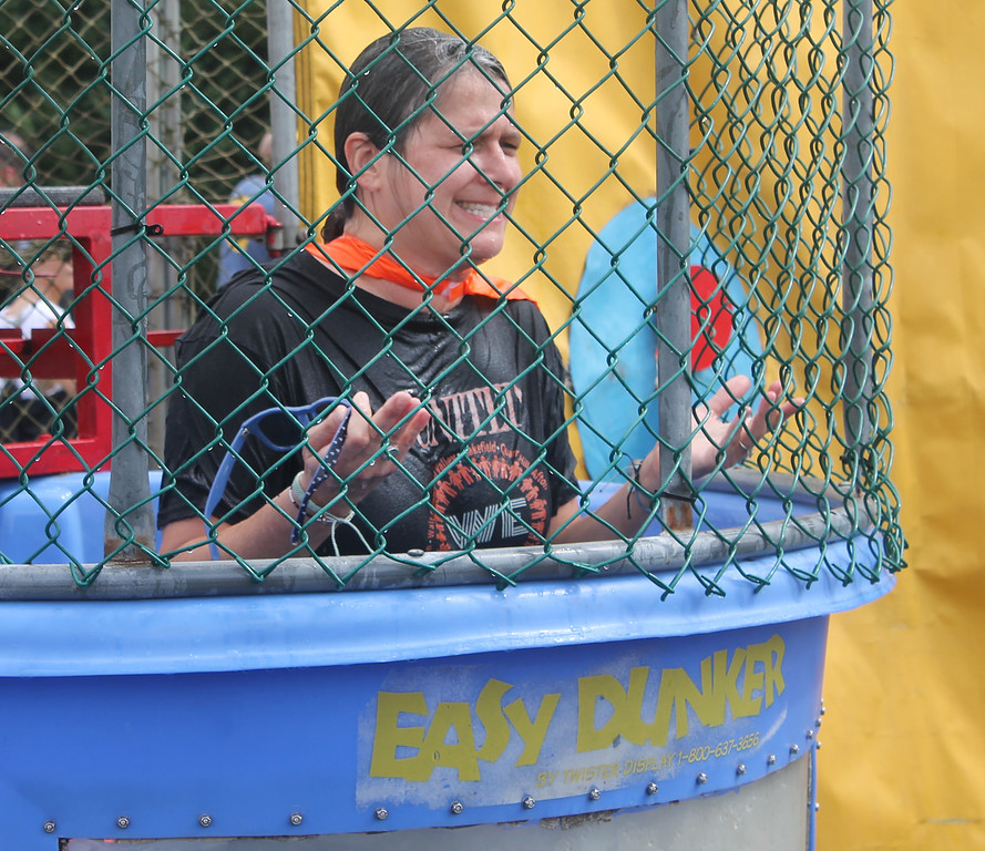 . Edgewood Principal Stephanie Hultquist emerges from the dunk tank\'s cold waters.