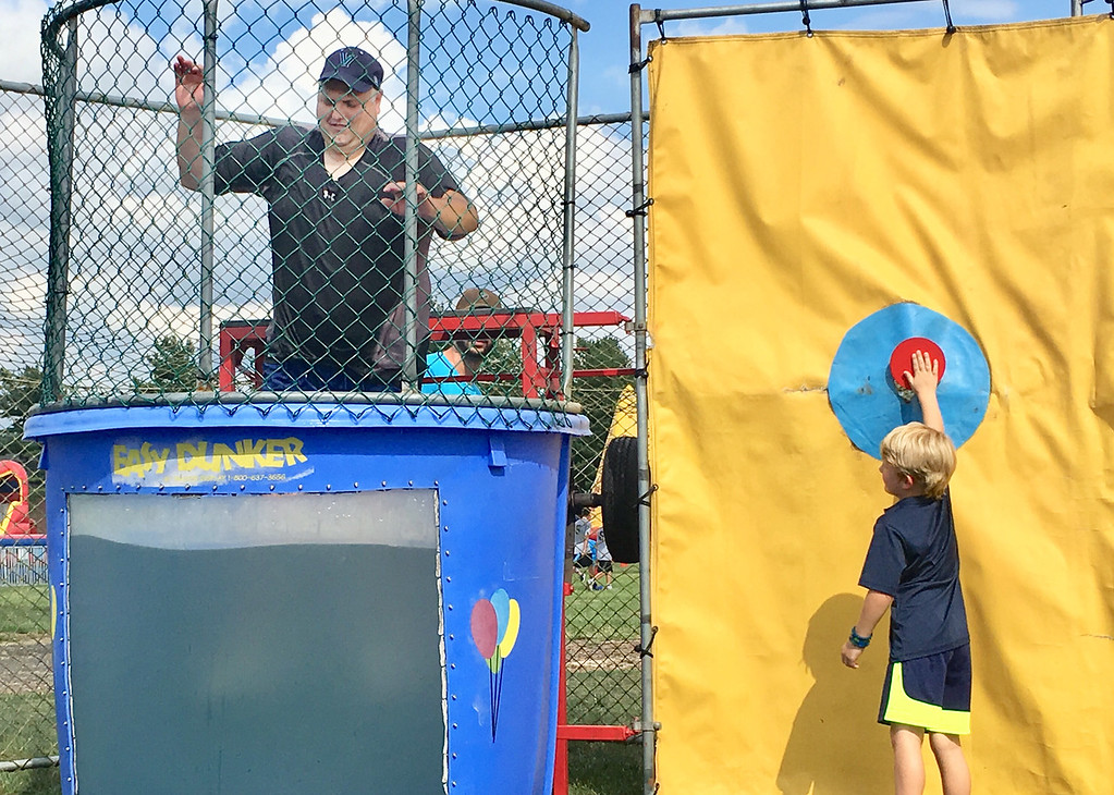 . A youngster sends John Lewis, the chairman of the Lower Makefield Board of Supervisors, into the cold waters of the dunk tank. Lewis donated the proceeds from his time in the dunk tank to the LMT Community Fund.