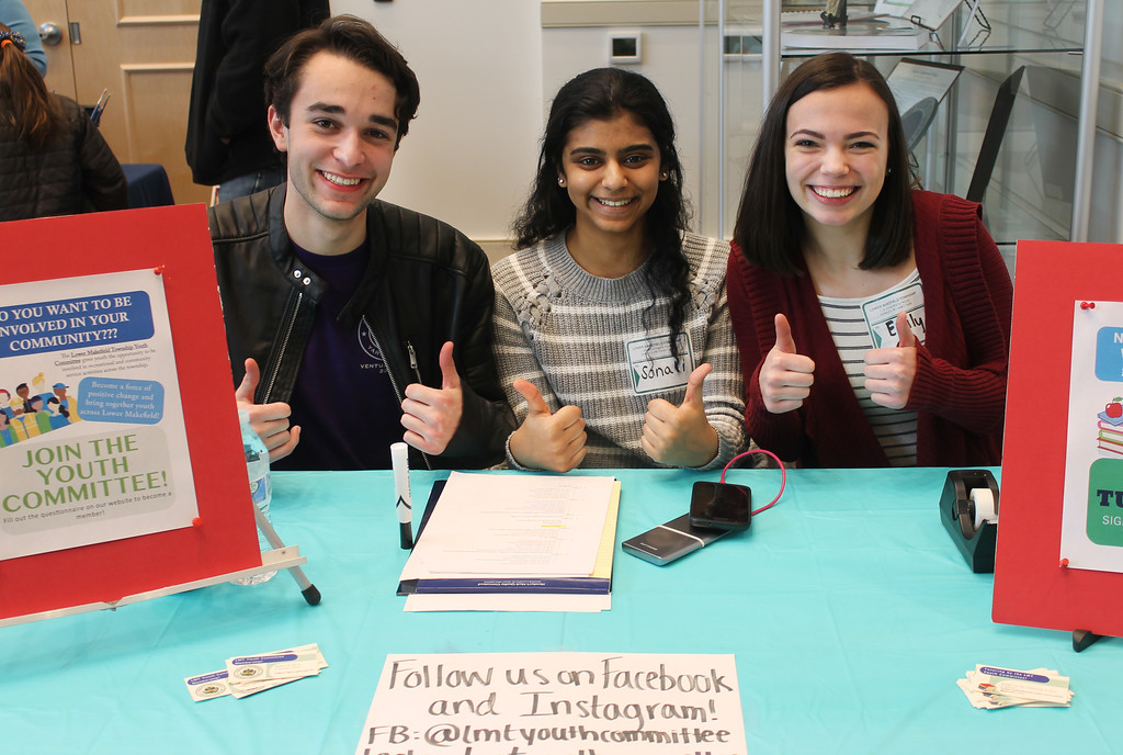. Members of the Lower Makefield Youth Committee, all seniors at Pennsbury High School, give a thumbs up to the new Community Center. From left are Phil Genovese, Sonali Deliwala, and Emily Huegler, chairperson.