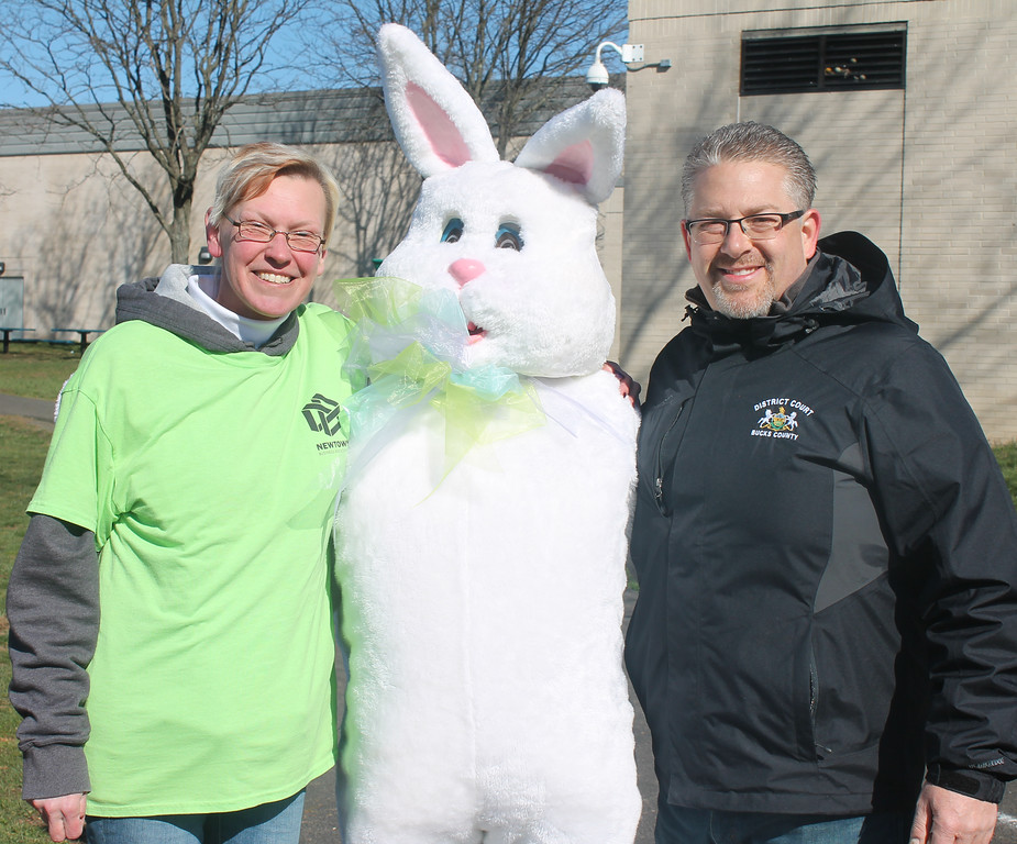 . The Easter Bunny greets Jess Grosso, who chaired the event for the Newtown Business Association, and Judge Mick Petrucci, who served as egg hunt announcer.