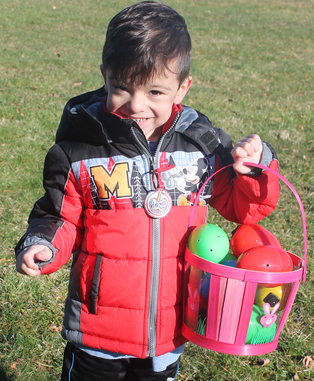 . What a haul for this young man, a participant in the egg hunt for the visually impaired.