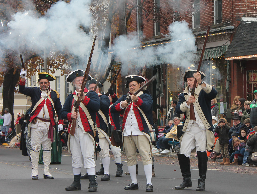 . 1st Crossing Volunteers from Crossing Community Church fire a musket salute on South State Street, Newtown.
