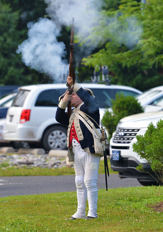. A Revolutionary War re-enactor starts the 10K Race with a bang. (photo by John Gleeson)