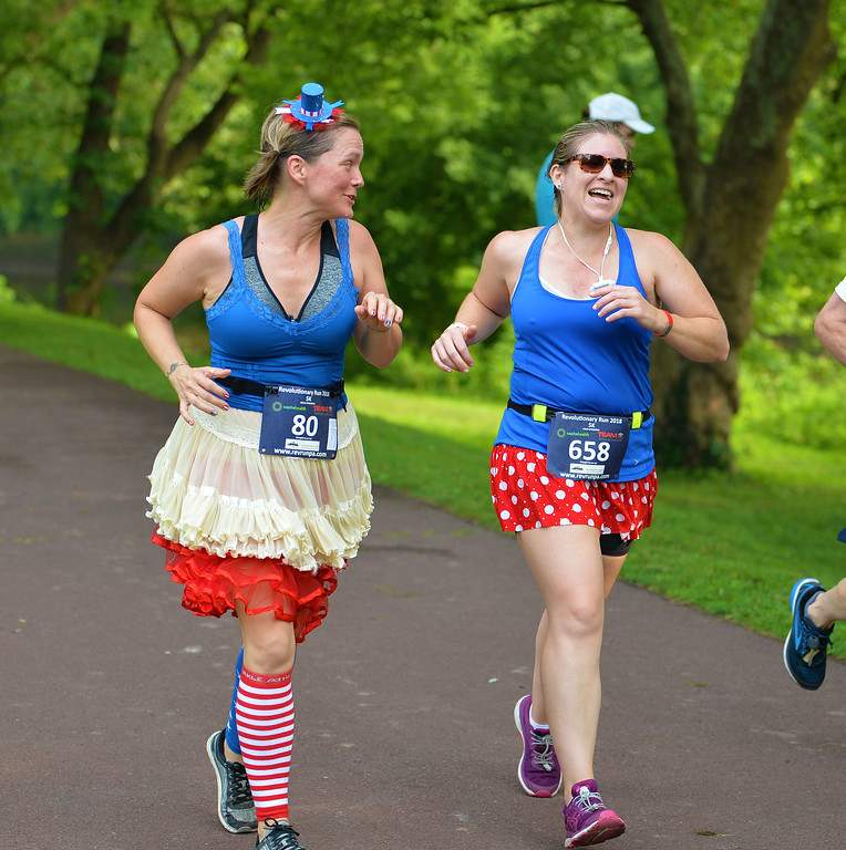 . Morrisville\'s Kaitlin Iffrig and Levittown\'s Sharon Rello sport patriotic garb in the 5K Race. (photo by John Gleeson)