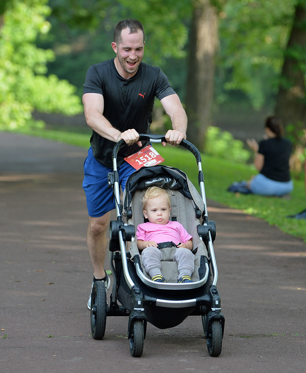 . Bruce White of Furlong with baby in tow finished 46th in the 10K. (photo by John Gleeson)