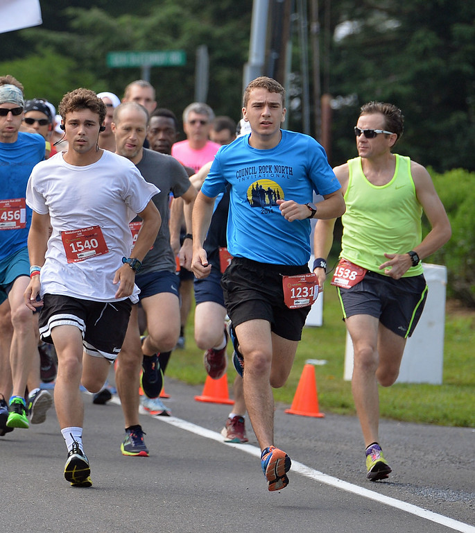 . Bryan Kellor (1231) of Newtown takes off in 10K Race. (photo by John Gleeson)