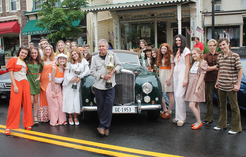 . Gene Epstein won Best of Show trophy for his antique 1953 Bentley. He is surrounded by members of the Council Rock North Sock \'N Buskin Club who came dressed for the 70s.
