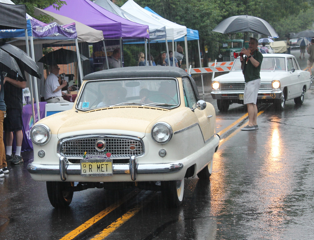 . A few vehicle owners opted to turn the wipers on and head back on the highway as the rain fell heavier at the show.