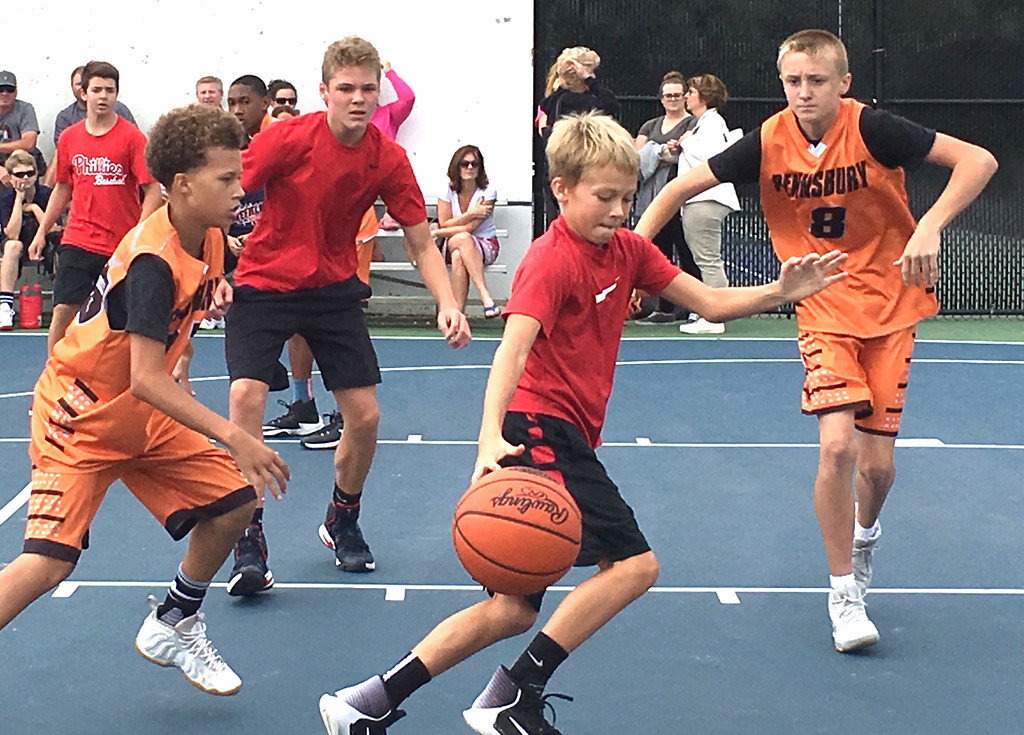 . Competing in the 3v3 Basketball Tournament.