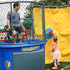 "Jeff Benedetto watches as his daughter, Faith, gets ready to dunk her dad. ""It was fun,"" she said."