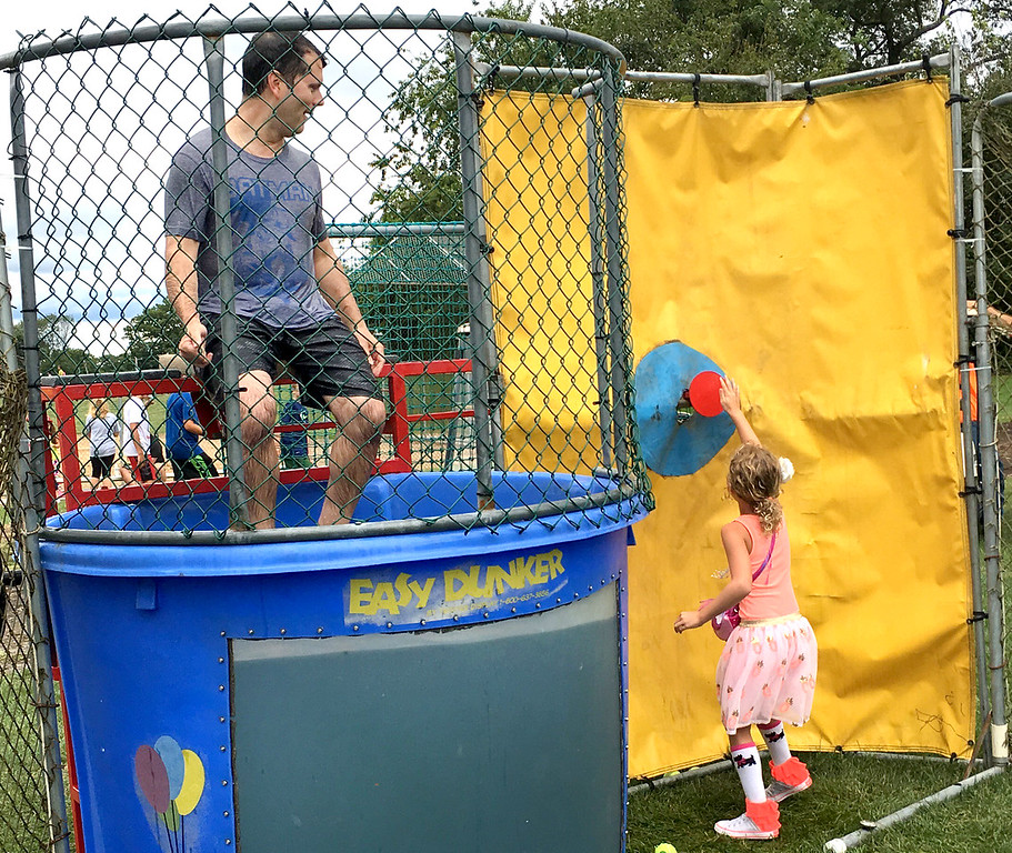 ". Jeff Benedetto watches as his daughter, Faith, gets ready to dunk her dad. ""It was fun,\"" she said."
