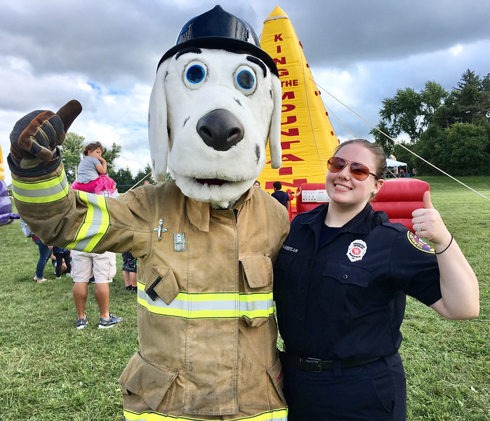 Sparky the Fire Dog and Amy Chamberlain from the Yardley-Makefield Fire Company give a big thumbs up to Lower Makefield's Community Pride Day.