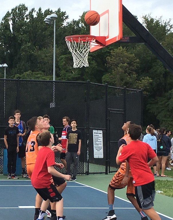 . A team competes in the 3v3 Basketball Tournament, which took place throughout the day.