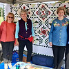 "Showing off ""Windblown Flowers,"" a quilt they are raffling, are members of the Newtown Quilters Guild, from left, Jane Nadig, President Regina Apuzo, Christy Stephenson, quilter and designer Sallie Lloyd and Barb McClintock. Mark your calendar for their upcoming Quilt Show, ""A Stitch in Time,"" Oct. 14 to 15 at the Lower Bucks Masonic Hall in Lower Makefield. Raffle tickets at $1 each or six for $5 will be sold at the show with the winner drawn on Oct. 17. INFO: NewtownQuiltersGuild.org."