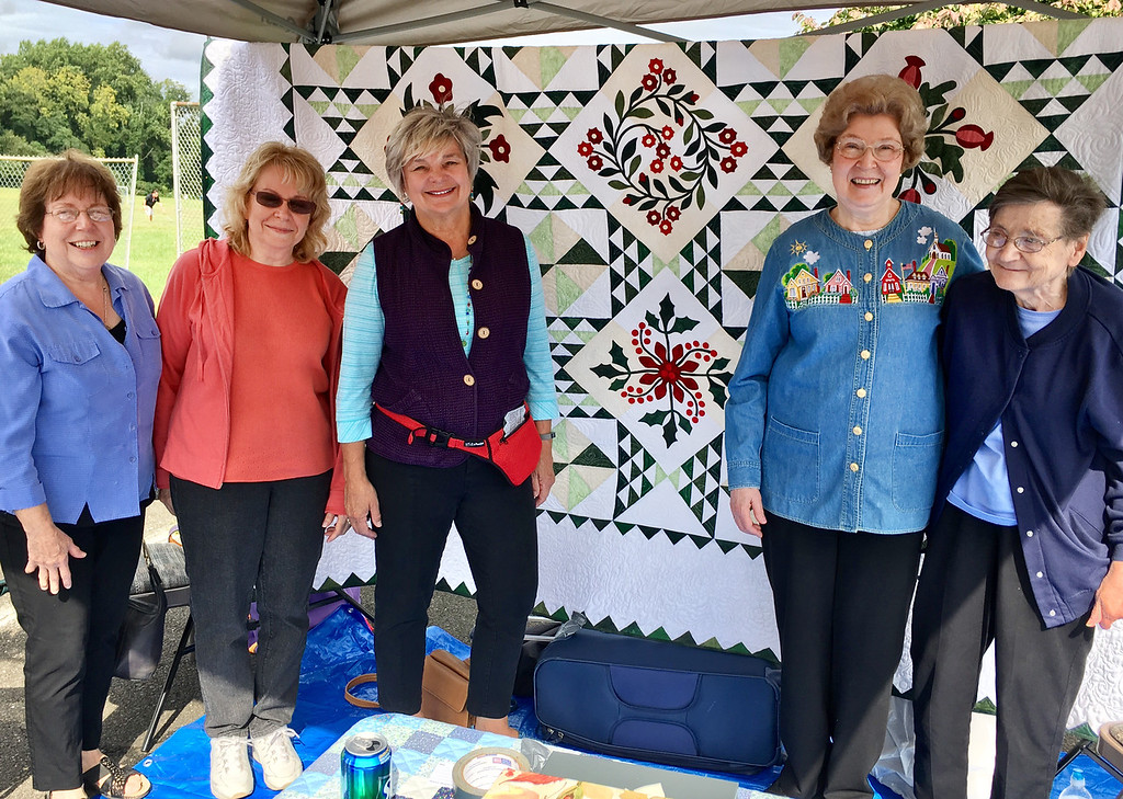 ". Showing off ""Windblown Flowers,\"" a quilt they are raffling, are members of the Newtown Quilters Guild, from left, Jane Nadig, President Regina Apuzo, Christy Stephenson, quilter and designer Sallie Lloyd and Barb McClintock. Mark your calendar for their upcoming Quilt Show, \""A Stitch in Time,\"" Oct. 14 to 15 at the Lower Bucks Masonic Hall in Lower Makefield. Raffle tickets at $1 each or six for $5 will be sold at the show with the winner drawn on Oct. 17. INFO: NewtownQuiltersGuild.org."