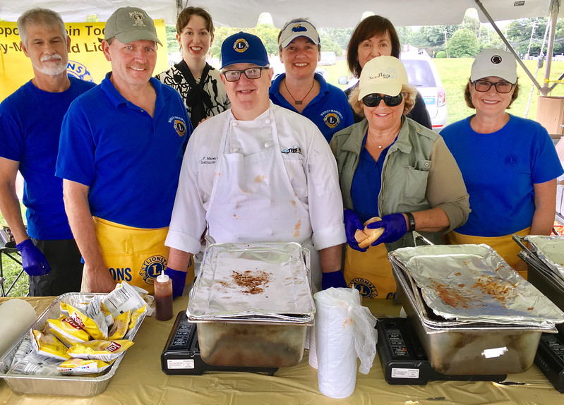 Colin Marsh and his team from the Yardley Lions Club serve some mouthwatering food at their Community Pride Day booth.