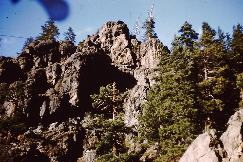 """1958 (Aug) - The """"Face"""" (top center rock) on the cliffs across the river from the Naches River cabin - Cliffdell, WA - From the Byron W. Yaden 35MM Slide Collection"""