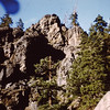 "1958 (Aug) - The ""Face"" (top center rock) on the cliffs across the river from the Naches River cabin - Cliffdell, WA - From the Byron W. Yaden 35MM Slide Collection"